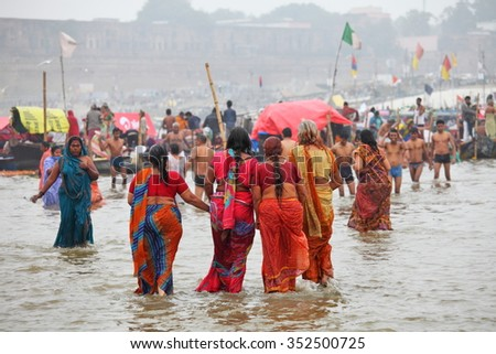 ALLAHABAD, INDIA - FEBRUARY 07, 2013: Thousands of Hindu devotees come to confluence of the Ganges and Yamuna River for holy dip during the festival Kumbh Mela. The world's largest religious gathering - stock photo