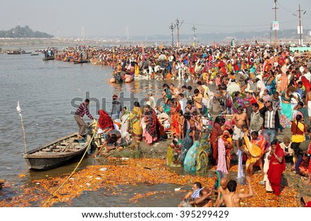 ALLAHABAD, INDIA - FEBRUARY 09, 2013: Thousands of Hindu devotees come to confluence of the Ganges and Yamuna River for holy dip during the festival Kumbh Mela. The world's largest religious gathering - stock photo
