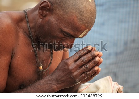 ALLAHABAD, INDIA - FEBRUARY 12, 2013: unidentified Hindu devotee is praying and reciting sacred texts