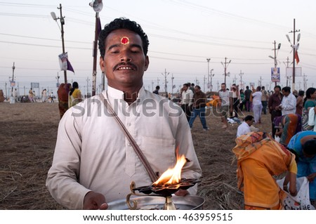 ALLAHABAD, INDIA - MARCH 07, 2013 : Thousands of Hindu devotees come to confluence of the Ganges and Yamuna River for holy dip during the festival Kumbh Mela. The world's largest religious gathering