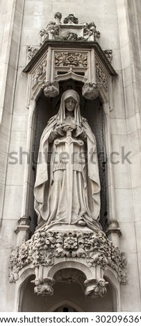 Allegorical sculpture of a woman with a sword - stock photo