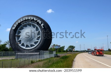 ALLEN PARK, MI - JULY 6: The Uniroyal Giant Tire, off Interstate I-94 near Detroit Metropolitan Airport, is shown here on July 6, 2014. It is the largest non-production tire scale model in the world.  - stock photo