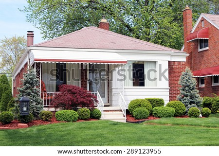 ALLEN PARK, MI-JUNE, 2015:  Typical mid western suburban home built after World War II.  These were small homes, usually averaging less than 1,000 square feet in size. - stock photo