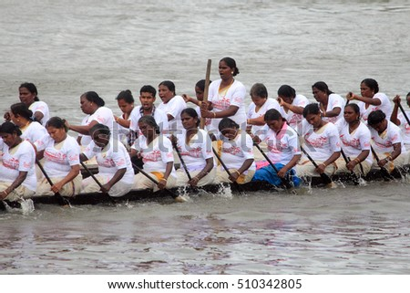 ALLEPPEY, INDIA - AUG 11 : An unidentified team of women participate in the most popular Nehru Trophy Boat race in August 11, 2011 in Alleppey,Kerala, India.