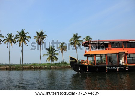ALLEPPEY, INDIA -JAN 29 : A house boat transports tourists around the backwaters on January 29, 2016 in Alleppey, India. House boat cruise is the top attraction of the inbound tourism in Kerala. - stock photo