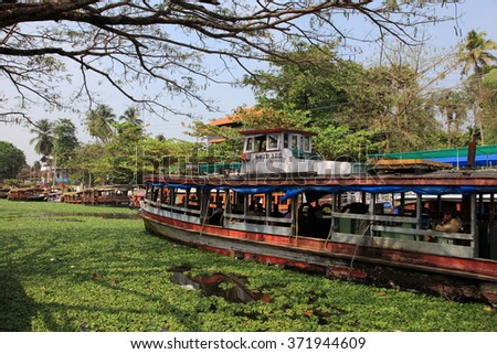 ALLEPPEY, INDIA - JAN 29 : A passenger boat transports people through the backwaters on January 29, 2016 in Alleppey, India. People of the region depend on boats for their transporting needs - stock photo