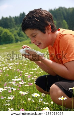 allergic child with handkerchief in Minesweeper - stock photo