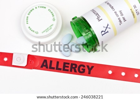 Allergy alert hospital wristband with medication and prescription bottle.