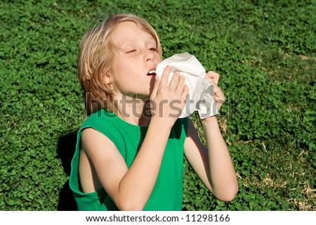 allergy,boy sneezing - stock photo