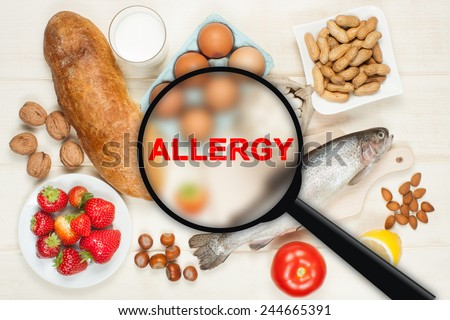 Allergy food concept. Food on wooden table - stock photo