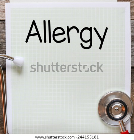 Allergy Handwritten on paper. Allergy Handwritten on paper note with stethoscope on wooden table