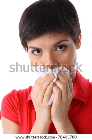 allergy or illness: close-up of young woman blowing her nose with tissue on white background (isolated on white) - stock photo