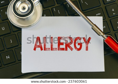 Allergy sign and stethoscope. Allergy sign and stethoscope. Medicine concept on computer keyboards - stock photo