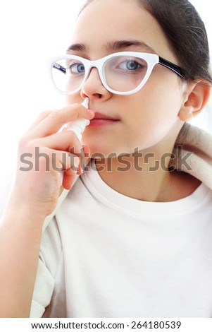 Allergy to pollen, girl dripping nose. Sick girl dripping nose drops  - stock photo