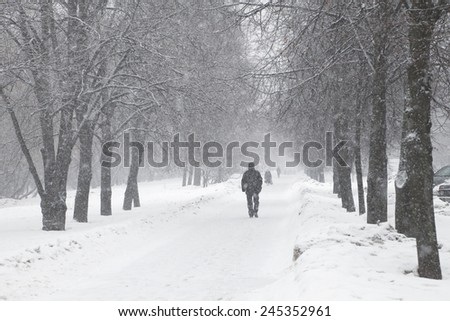 Alley in a town during a snow storm - stock photo