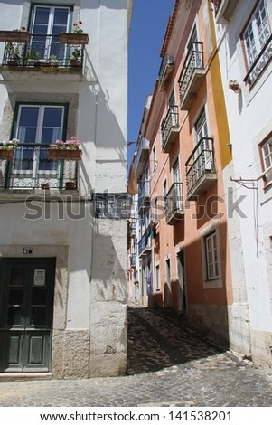 Alley in Alfama district in Lisbon, Portugal - stock photo