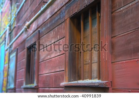Alley in Locke California with barred and boarded up windows - stock photo
