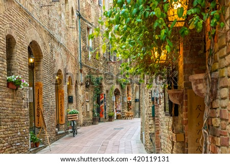Alley in old town San Gimignano Tuscany Italy - stock photo