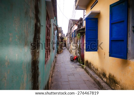 Alley in the old town of Hoi An - stock photo