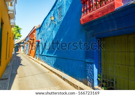 Alley leading past historic colonial houses in the Getsemani neighborhood of Cartagena, Colombia - stock photo
