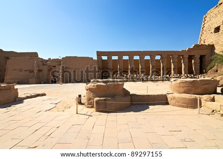 Alley of ram-headed sphinxes in the main court of Karnak temple of Amun, Egypt - stock photo