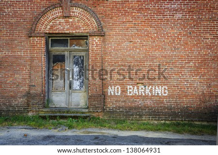 Alley with a funny sign - stock photo