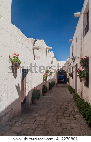 Alley with flowers in Santa Catalina monastery in Arequipa, Peru - stock photo