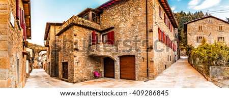 Alleys in medieval mountain village in Tuscany characterized by houses with walls of stones derived from the Renaissance - stock photo