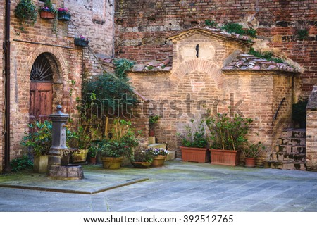Alleys the beautiful medieval town in Tuscany. - stock photo