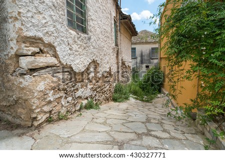 Alleyway in an old Greek town. - stock photo