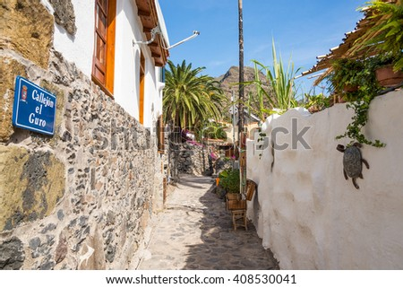 Alleyway in the small town El Guro in the Valle Gran Rey on La Gomera. El Guro is home of many artists who spend their life on the island. The artists prettify the village with their handicrafts - stock photo