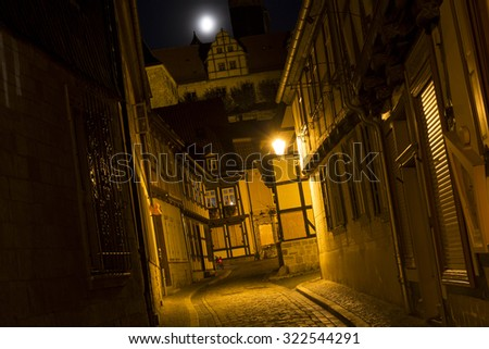 Alleyway in the town of Quedlinburg, Germany, at night - stock photo
