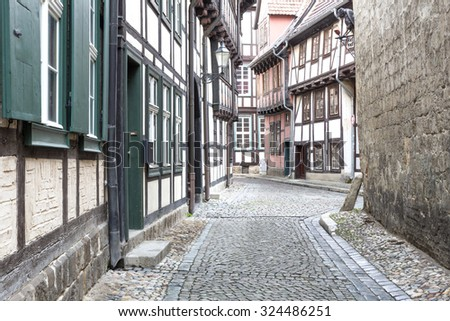 Alleyway with half-timbered houses in Quedlinburg town, Germany - stock photo