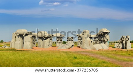 ALLIANCE, NE - AUGUST 2014: Carhenge, famous car sculpture recreating the Stonehenge in England created and installed by Jim Reinders dedicated to his father in Alliance, Nebraska, USA. August 16,2014 - stock photo