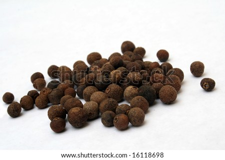 Allspice fruit on white background - stock photo