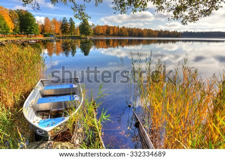 Alluminium boat in Swedish autumn scenery - stock photo