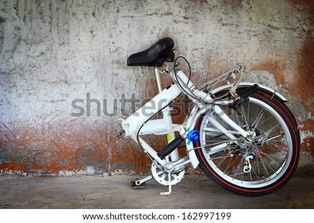 Alluminium folding bicycle  and old wall