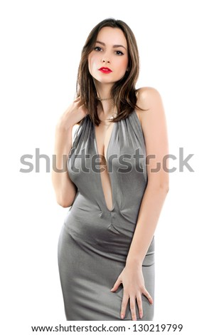Alluring woman posing in grey dress with a plunging neckline. Isolated on white - stock photo
