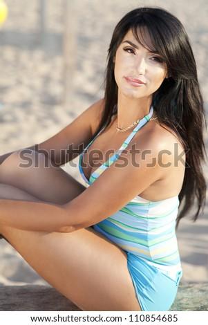 alluring woman relaxing near sea in swimwear thinking about boyfriend .Beautiful happy girl on beach enjoying summer sun.Romantic lady at vacation holidays at ocean.Sexy brunette bikini model resting - stock photo
