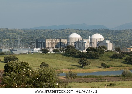 Almaraz nuclear power plant in the center of Spain, surrounded by oak hardwood - stock photo