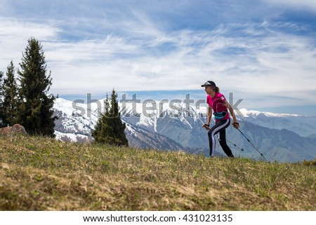 ALMATY, ALMATY DISTRICT,KAZAKHSTAN - MAY 22, 2016: Open competition SKY RUNNING 2016 held in Eliksay gorge. A girl runs up to the mountain participating in the competition