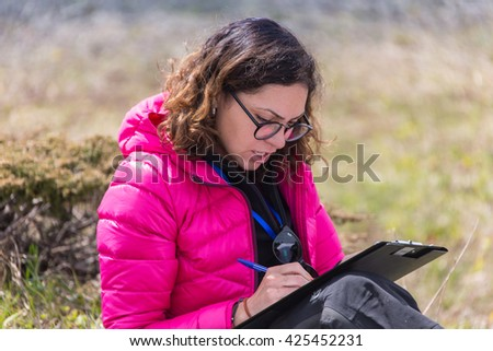 ALMATY, ALMATY DISTRIKT,KAZAKHSTAN - MAY 22, 2016: Open competition SKY RANNING 2016 held in Eliksay gorge. A girl runs up to the mountain named Bukreeva participating in the competition