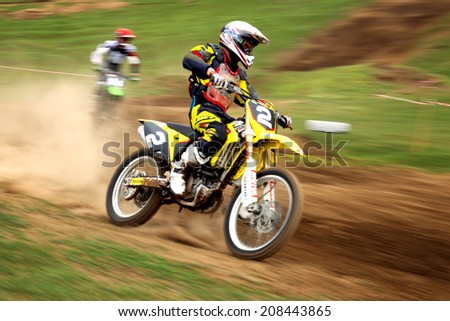 """ALMATY, KAZAKHSTAN - APRIL 14 A.Ayteliev(N2) and other at the Motocross competition """"Fabrichny Cup""""- Open Championship of Kazakhstan on April 14, 2013 in Almaty, Kazakhstan. - stock photo"""
