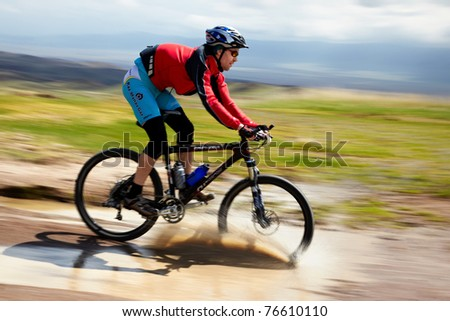 "ALMATY, KAZAKHSTAN - APRIL 30: A.Kaspersky (N6) in action at Adventure mountain bike cross-country marathon in mountains ""Jeyran Trophy 2011"" April 30, 2011 in Almaty, Kazakhstan. - stock photo"