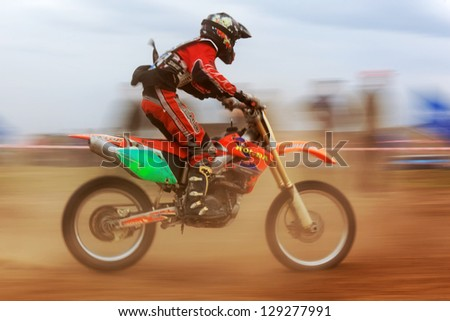 """ALMATY, KAZAKHSTAN - APRIL 10: A.Laskin(17) at the Motocross competition """"Fabrichny Cup""""- Open Championship of Kazakhstan on April 10, 2011 in Kargaly, Kazakhstan. - stock photo"""