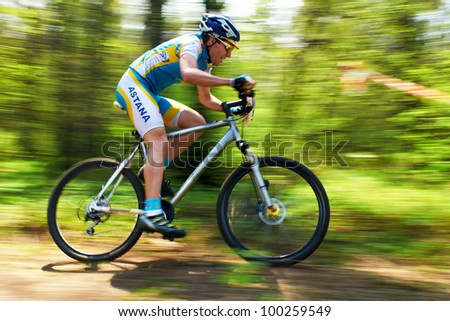ALMATY, KAZAKHSTAN - APRIL 15: A.Nuriev (30) in action at cross-country relay race April 15, 2012 in Almaty, Kazakhstan. - stock photo