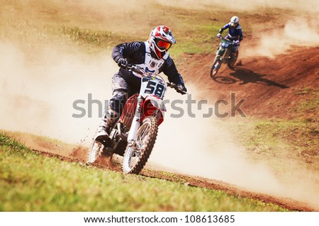 """ALMATY, KAZAKHSTAN - APRIL 22 A.Platonov (N58) at the Motocross competition """"Fabrichny Cup""""- Open Championship of Kazakhstan on April 22, 2012 in Almaty, Kazakhstan. - stock photo"""
