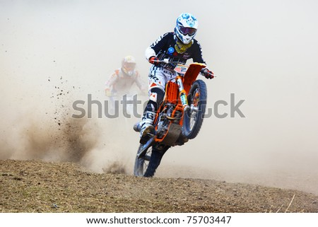 "ALMATY, KAZAKHSTAN - APRIL 10: A.Simonenko(2) at  Motocross competition ""Fabrichny Cup""- Open Championship of Kazakhstan, on April 10, 2011 in Kargaly, Kazakhstan. - stock photo"