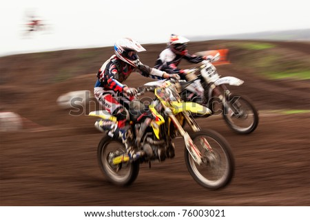 "ALMATY, KAZAKHSTAN - APRIL 17: A.Simonenko(2) in action at  Motocross competition ""Fabrichny Cup""- Open Championship of Kazakhstan, on April 17, 2011 in Kargaly, Kazakhstan."