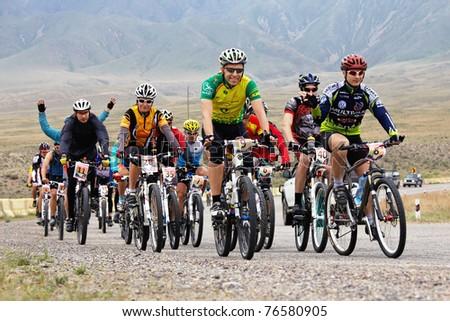 "ALMATY, KAZAKHSTAN - APRIL 30: Adventure mountain bike cross-country marathon in mountains ""Jeyran Trophy 2011"" April 30, 2011 in Almaty, Kazakhstan. - stock photo"